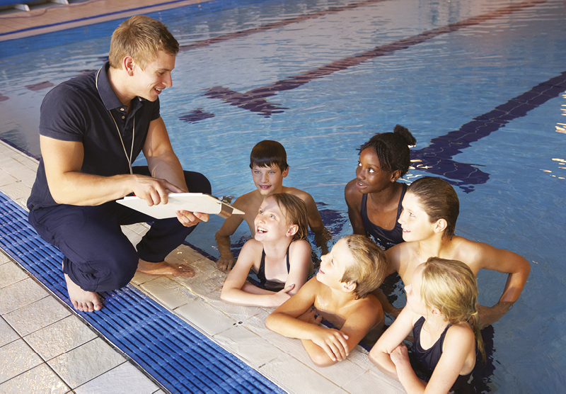Swimming instructor with children